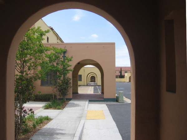 Simple geometry of functional architecture influenced by the Spanish Colonial Revival style.