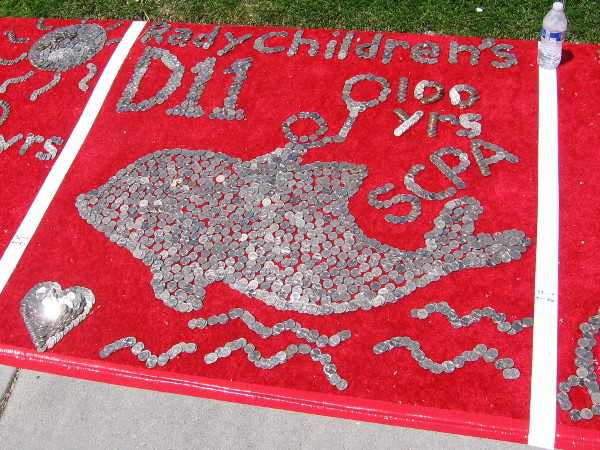 A dolphin and a heart glitter in the sunshine.