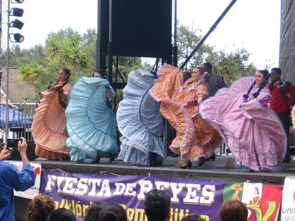 Traditional Mexican folk dancers in long flowing skirts dazzle the big crowd.