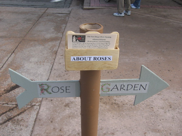 Sign shows the way to the Rose Garden across Park Boulevard.