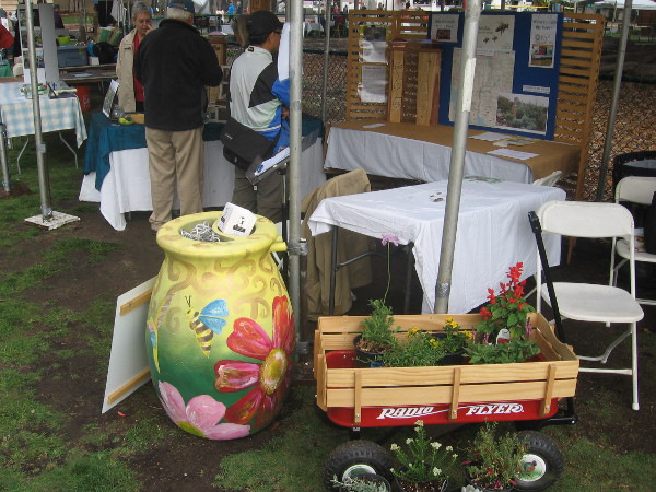 Another exhibitor near the Moreton Bay Fig Tree and Natural History Museum has a cool trash can painted with flowers and a bee.
