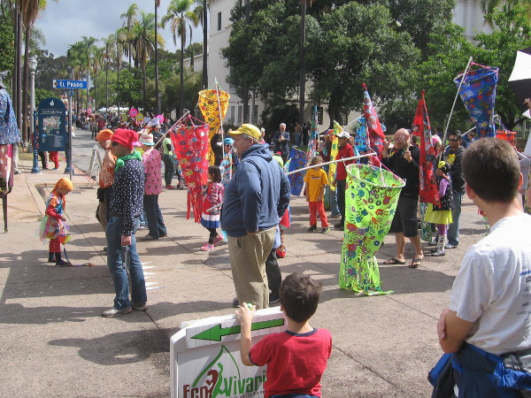 Garden Party of the Century parade turns the corner and heads down El Prado toward Plaza de Panama.