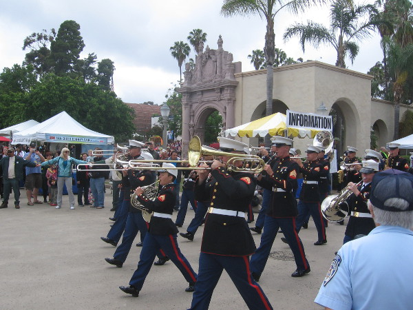 The band leads the way as marchers from the Marine Corps Recruit Depot enter Plaza de Panama.
