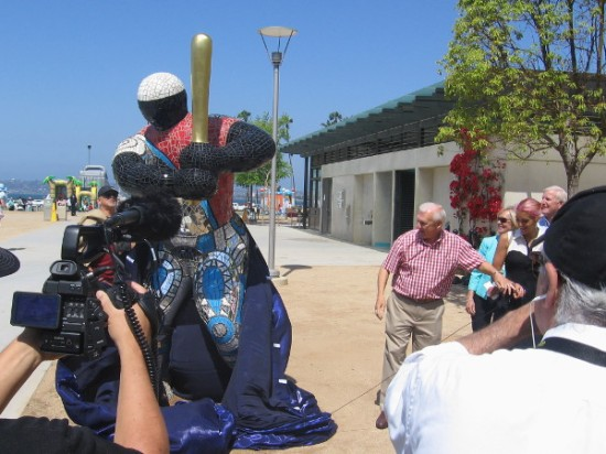 Ron Roberts and the great granddaughter of renowned artist Niki de Saint Phalle reveal a sculpture titled 19 Baseball Player.