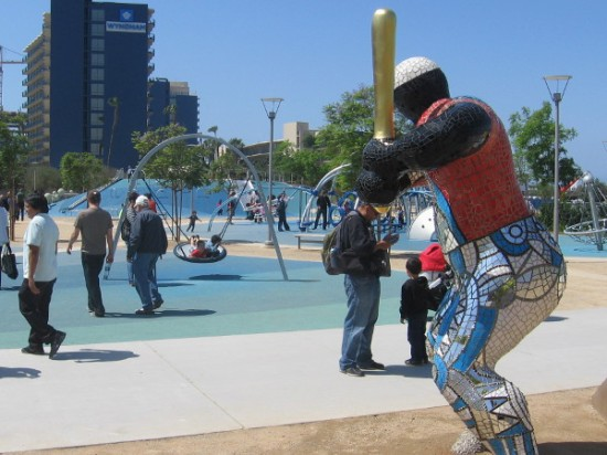 San Diego's beloved baseball legend Tony Gwynn holds a bat and faces a very large pitching mound (with slides)!