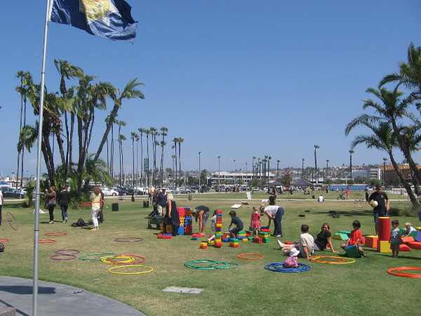 Kids play on the grass by a flag that flies above the San Diego County Law Enforcement Memorial.