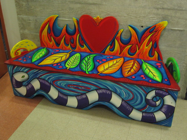 One of several colorful benches inside Building 202, home to small museums and galleries.