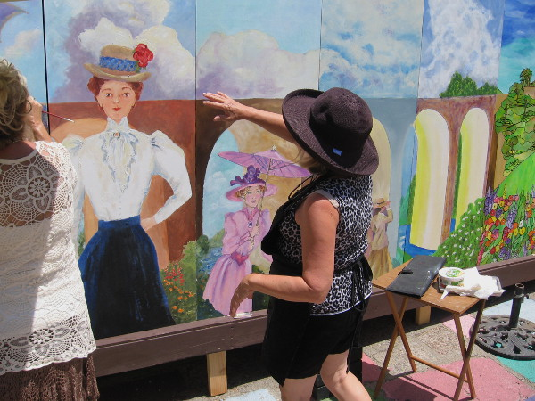 Local artists put the finishing touches on the 20 foot long 1915 Centennial Mural in Balboa Park.