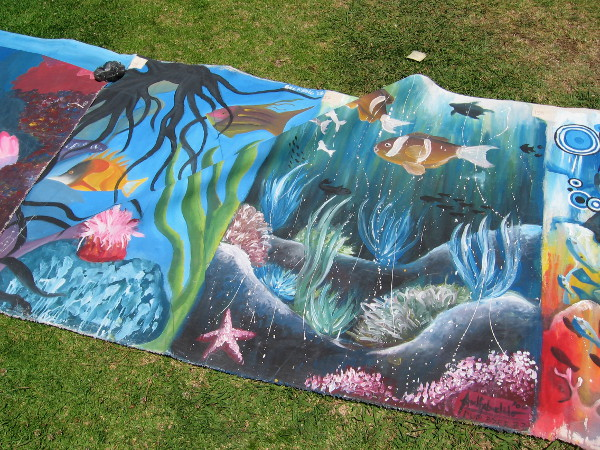Painted underwater scenes on the grass at the Balboa Park Centennial 2015 Philippine American Celebration.