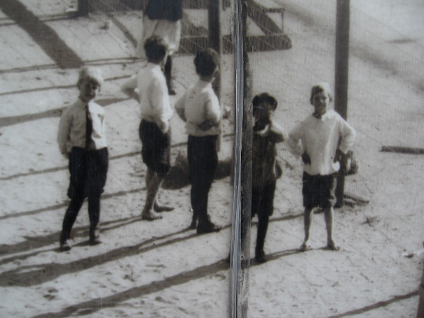 Second panel of photo mural shows kids in the Rose Park Playground at Eleventh and Island in 1915.