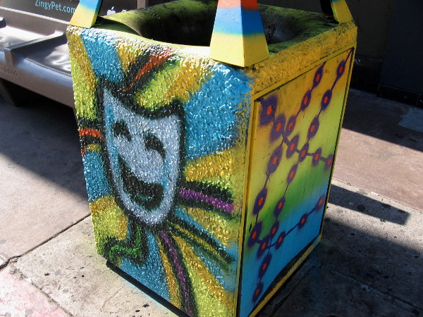 Many of the trashcans have a carnival theme, with masks, happy faces and crazy fun.
