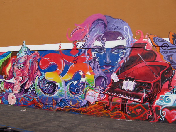 Piano, face and mad swirls of color. More awesome street art in uptown San Diego.