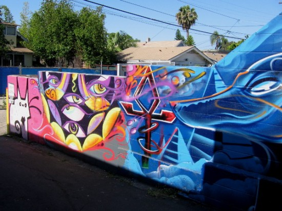 Spray paint mural contains Egyptian symbols. A dazzling display of human creativity.