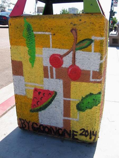 These trashcans with images of food are located near Normal Street.