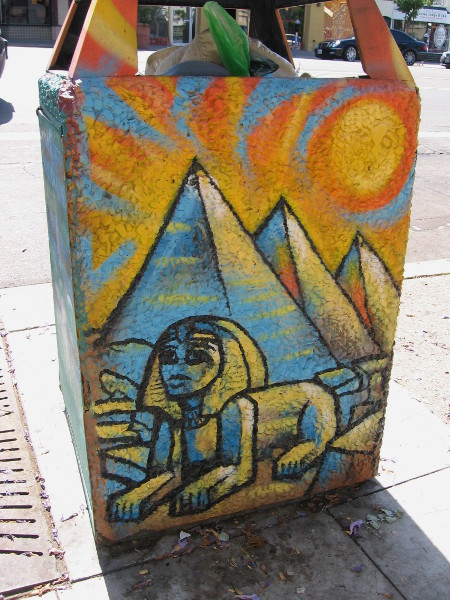 Trashcan with Sphinx and pyramids is appropriate for the Egyptian Quarter, near the intersection of University and Park Boulevard.