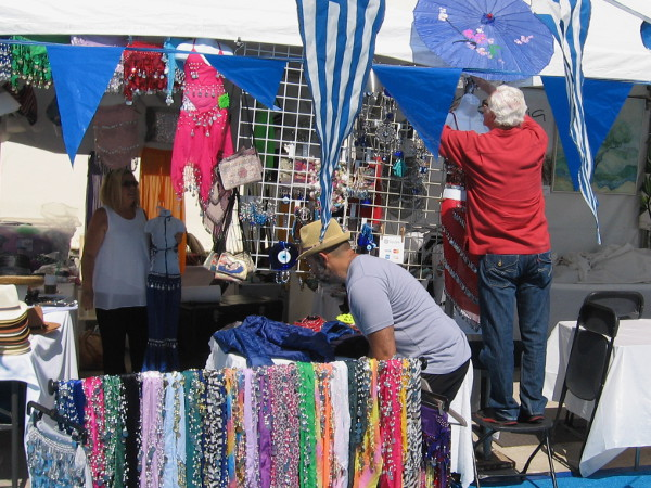 Flags, decorations and colorful wares are a feast for the senses outside St. Spyridon Greek Orthodox Church.