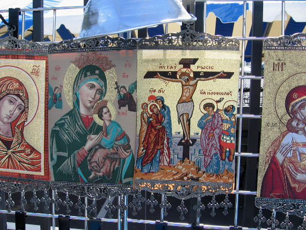 Orthodox religious icons displayed by one tent include familiar Christian symbols.