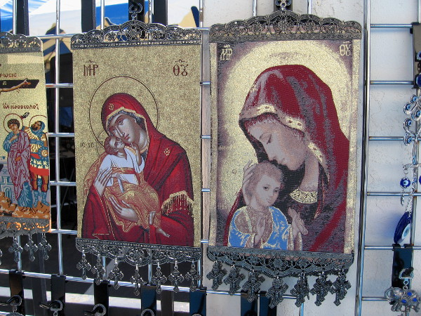 Icons of Mary and infant Jesus appear as if they're gilded in the San Diego morning sunshine.