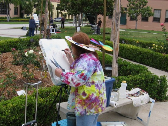 This creative lady at an easel sported a cool paint palette hat!