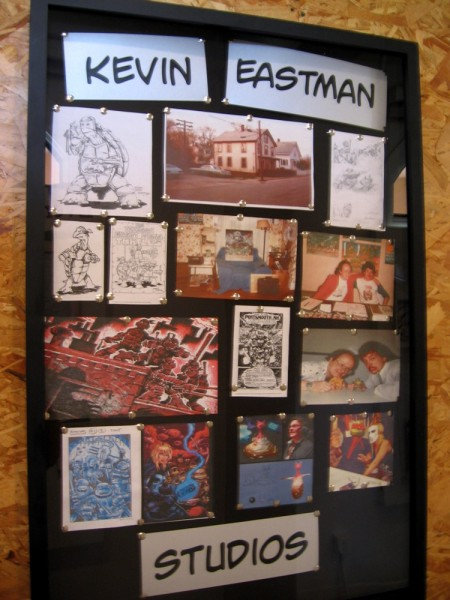 Images in one display show some work of comic artist Kevin Eastman and the studio where he has worked.