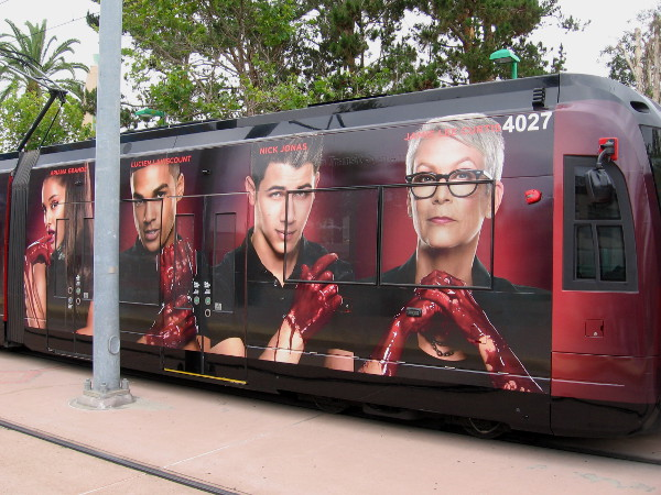 Faces of Scream Queens on a San Diego trolley include Ariana Grande, Lucien Laviscount and Nick Jonas.