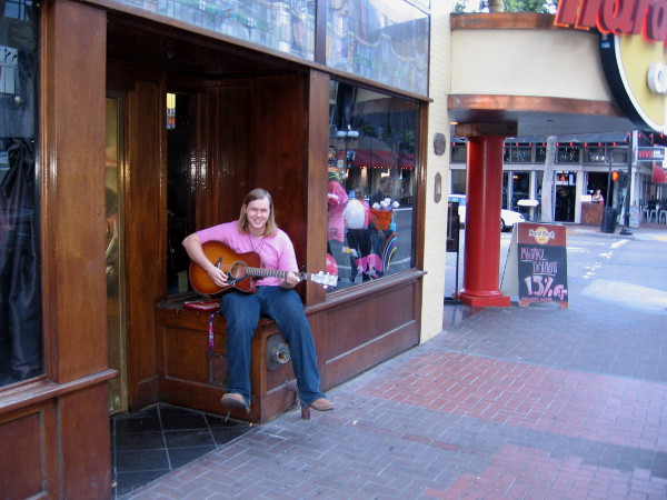 While I walked around, I spotted this cool guitarist making music by the door of the Hard Rock Cafe.