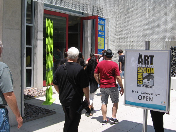 People enter the Art of Comic-Con exhibit, opening today at the downtown San Diego Public Library.