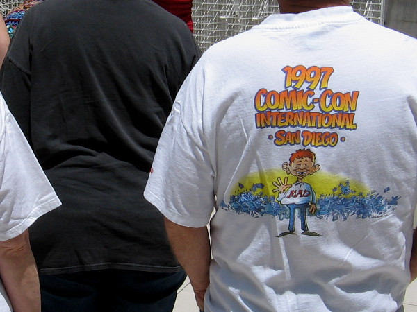 Someone heading in to check out the gallery is wearing a 1997 Comic-Con International shirt.