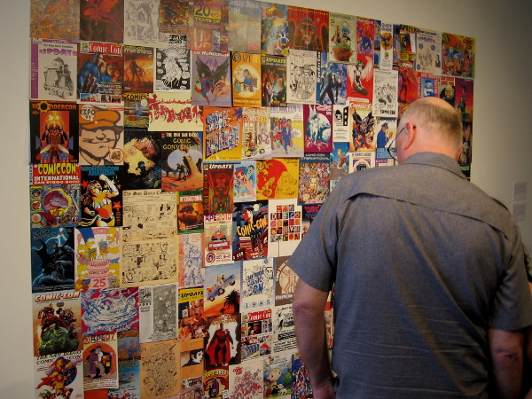 A cool mural composed of covers from past San Diego Comic-Con programs, plus other affiliated conventions.
