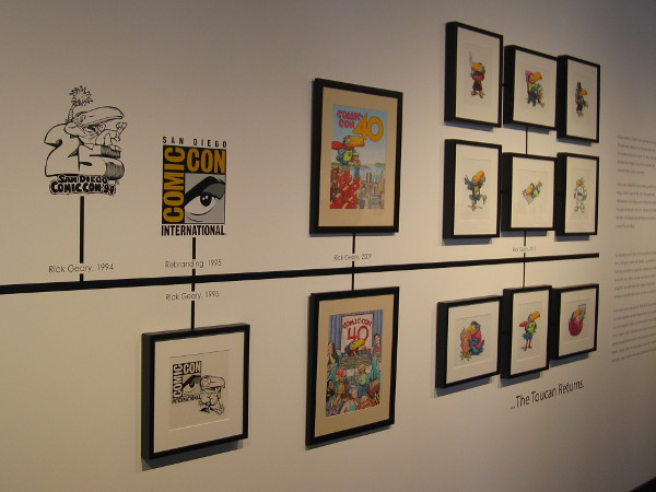This part of the exhibit traces the history of the Comic-Con International logo and the development of the popular toucan mascot.