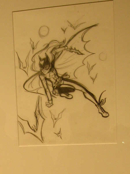 A penciled panel featuring Batgirl in action. Part of a cool display which demonstrates the processes involved in creating a comic book.