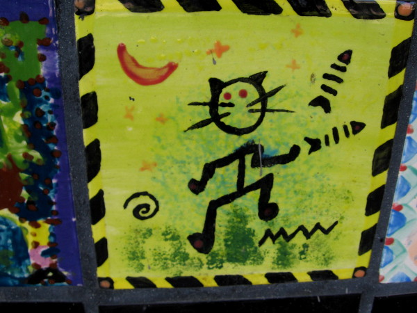 Cool cat dances under a crescent moon.
