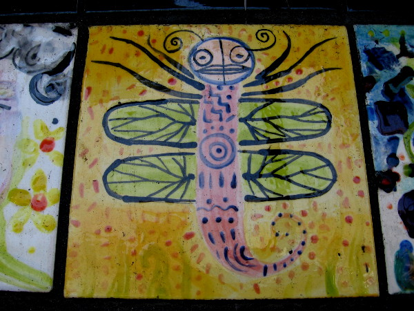 A fun dragonfly with a human-like face.
