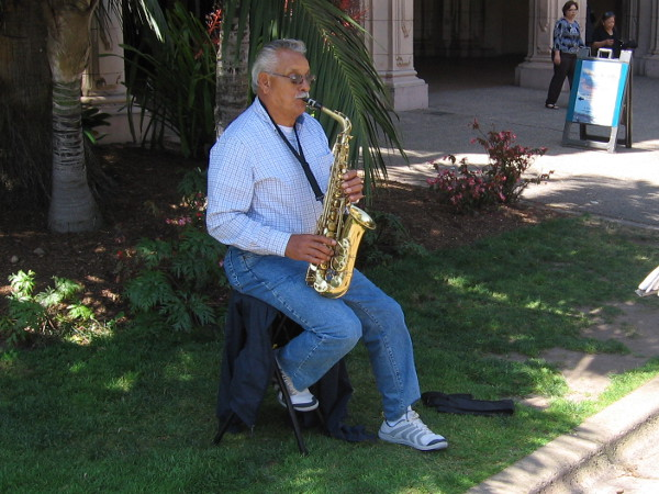 This gent was playing a cool sax in the shade.