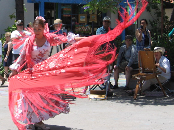 The energetic Spanish folk dancing causes colorful fabric to fly and twirl like a gauzy dream.