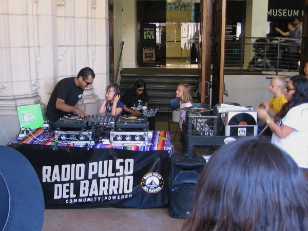 Radio Pulso del Barrio, an internet station out of Barrio Logan, was teaching one and all how to be a DJ for the day!