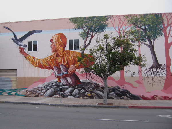 Fintan Magee, famous Australian street artist, painted the Hunger mural in San Diego's East Village.