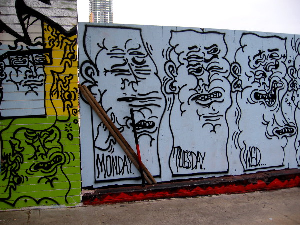 Graffiti faces are all squinched up on the wall between SILO in Makers Quarter and F Street in East Village.