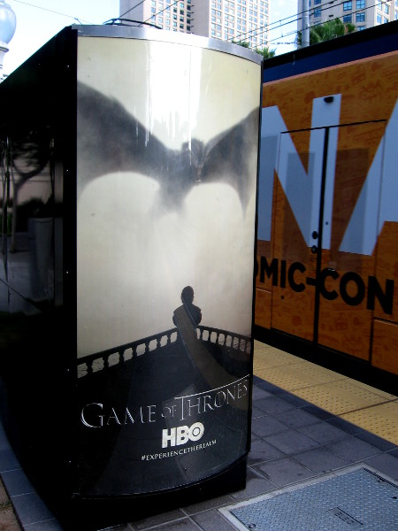 Game of Thrones advertisement at a trolley station. A Conan Live at Comic-Con trolley wrap passes by.