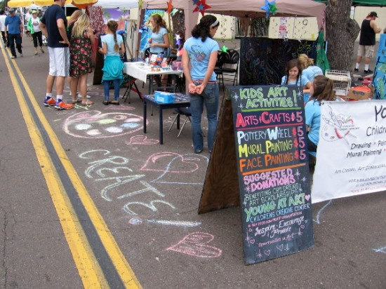 Kids were invited to express themselves with pottery, painting and chalk art.