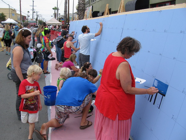 Anyone could participate in painting a small square in this large mural!