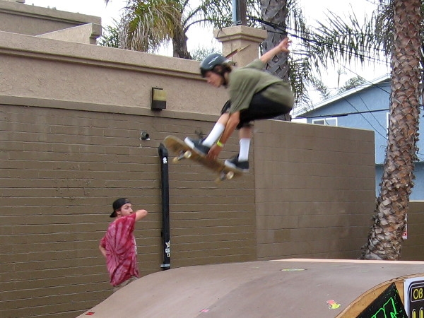 Skater catches huge air as he performs trick from a ramp, wowing everybody watching!