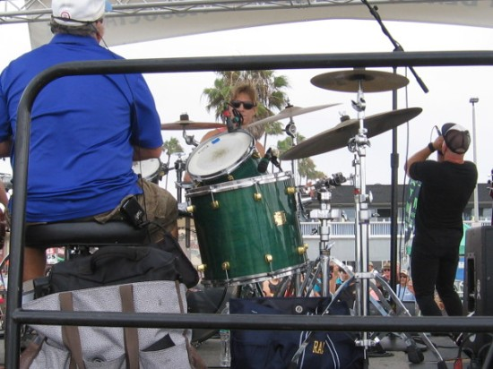 Justin Markland peers at me over drums while Randy Jones entertains the Ocean Beach crowd with irrepressible vocal and physical energy.