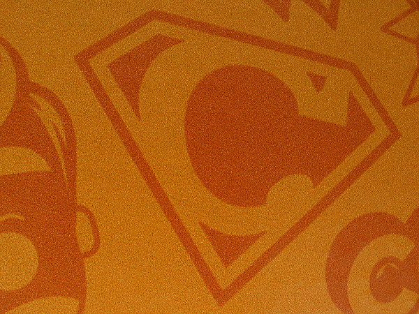 Or perhaps Conan O'Brien will wear a Superman-style emblem that warns all villains of his heightened powers, which include flaming hair.