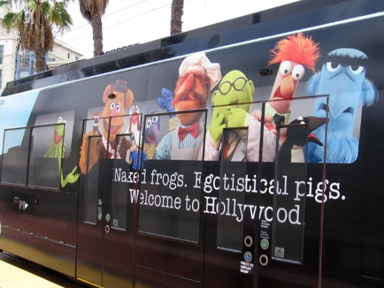 Kermit drives a trolley full of Muppet fun. Naked frogs. Egotistical pigs. Welcome to Hollywood.