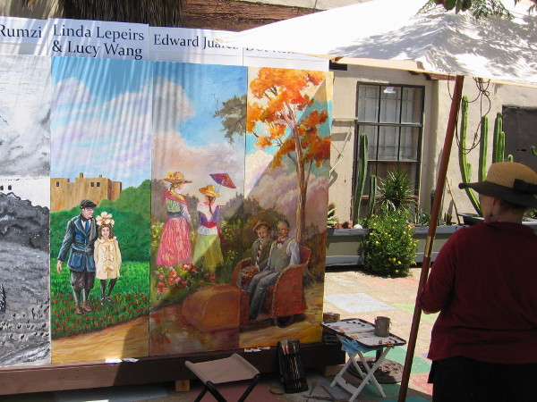 Artist studies the right end of the 20 foot long mural. That golden tree looks like it could be transplanted right into Spanish Village!