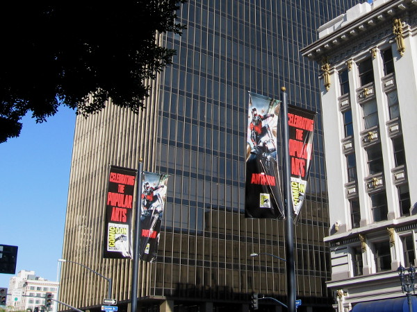 Large Marvel Ant-Man movie banners flutter in the breeze down the center of Broadway.