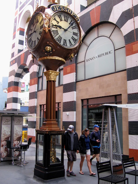 Shoppers walk past the beautiful Jessop Street Clock, a landmark in downtown San Diego for over a hundred years.