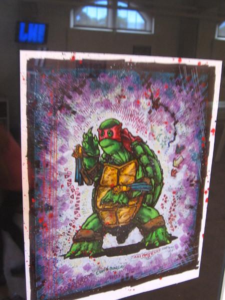 Colorful graphic depicts Raphael, of the Teenage Mutant Ninja Turtles.