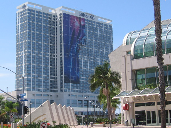 A new San Diego Comic-Con building wrap going up on Hilton Bayfront today is a bit of a mystery.
